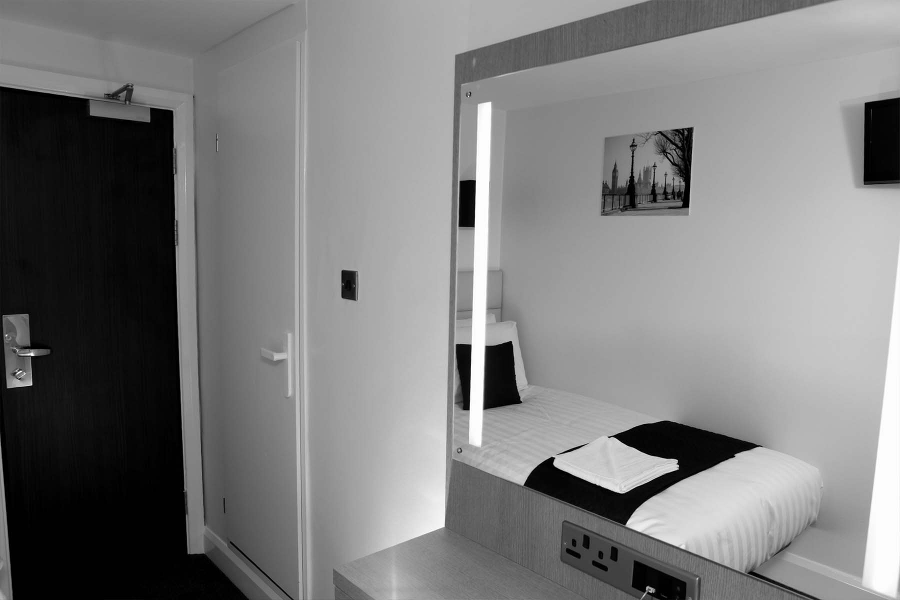 the omega hotel single bedroom